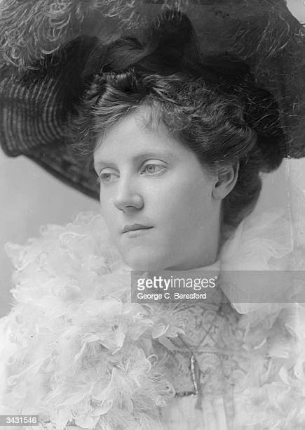 Miss V Forrestor wearing an Edwardian feathered hat and boa.
