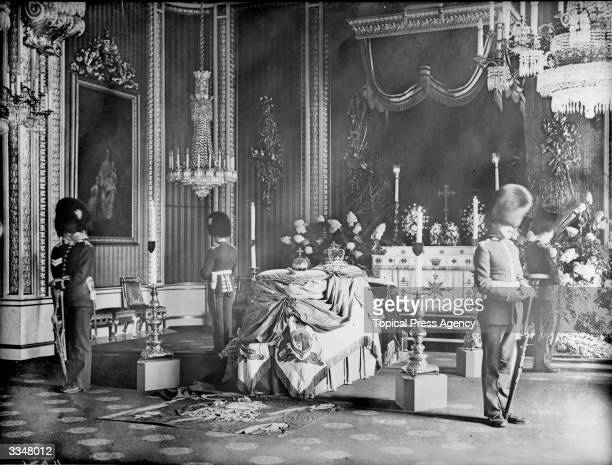 Guards surround the coffin at the private lying in state of King Edward VII at Buckingham Palace, London.