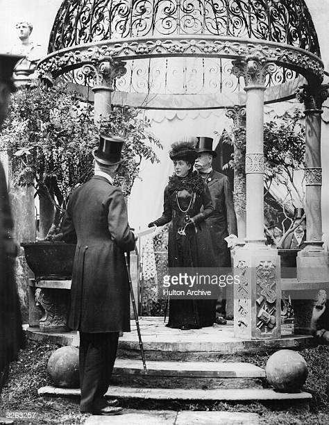 Queen Alexandra viewing an exhibit at the Royal Horticultural Society's Spring Show at Chelsea