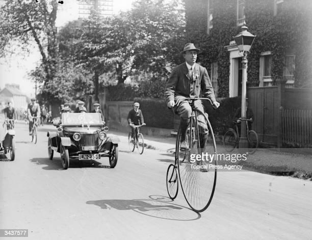 A man riding a penny farthing during a veteran cycling meet in Esher Surrey