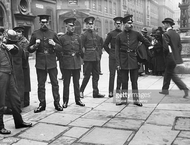 Officers of the Royal Irish Constabulary outside Bow Street magistrates court in London where Sir Roger Casement a nationalist who worked for the...