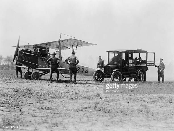 May 1918Philadelphia PA Opening of aerial mail service in Philadelphia PA Transfer of mail bags from US mail wagon to the airplane about to start for...