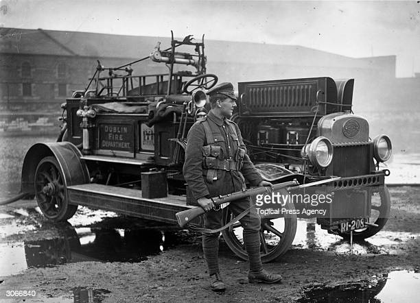 Soldier with a drawn bayonet guarding a fire engine belonging to Dublin Fire Department