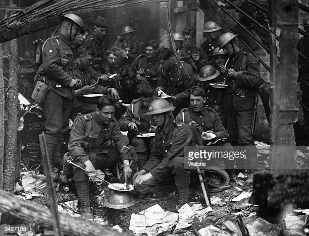 Soldiers having a meal in the remains of the Custom House Dublin burned by the IRA during nationalist unrest
