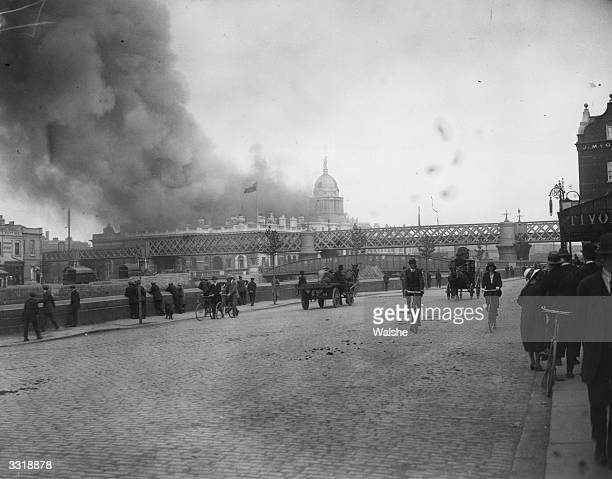 The Custom House, headquarters of the British Civil Service at Dublin, on fire after an Irish Republican Army attack.
