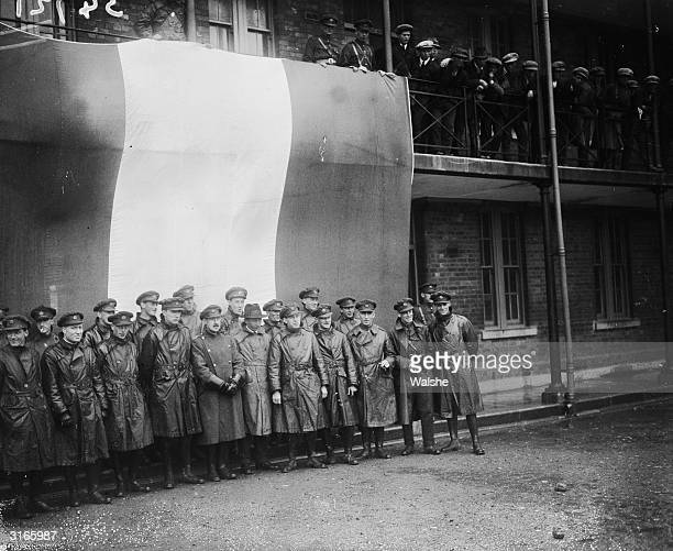 Irish Republican Army officers including General O'Connor gathered in front of the Tricolour flag after the evacuation of the British troops from...