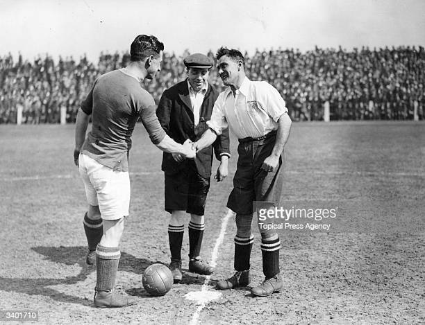 Team captains from Preston North End FC and Hudderfield Town FC shake hands before kick off