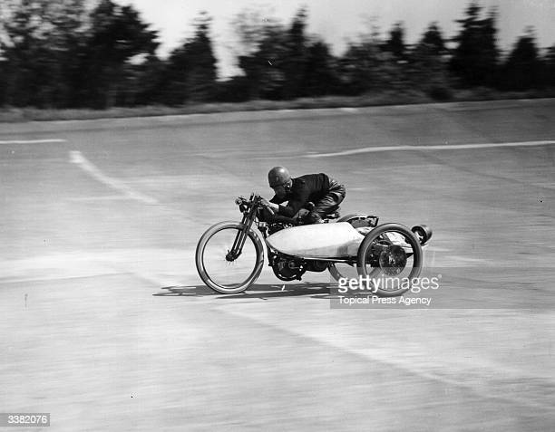 Motorcyclist F Dixon breaking a speed record on Brooklands racetrack in Surrey