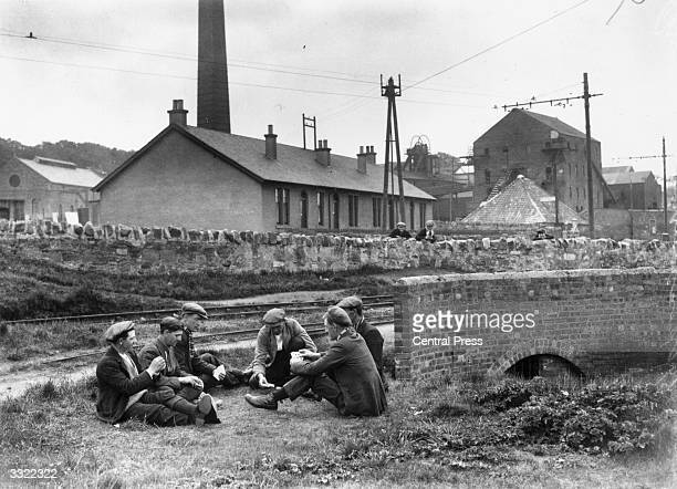 Group of miners passing the time with a game of cards outside Prestonpans Colliery, East Lothian, during industrial action at the time of the General...