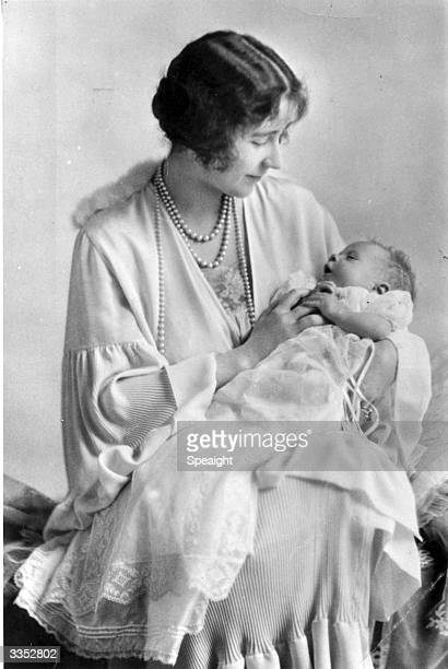 Elizabeth, Duchess of York holding her baby, the future Queen Elizabeth II.
