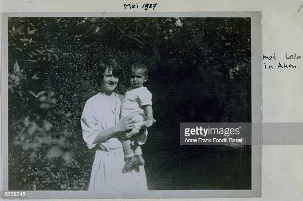 EXCLUSIVE Lala holds frowning baby Margot Frank the sister of Anne Frank in her grandmother's garden Aachen Germany Taken from the photo album of...