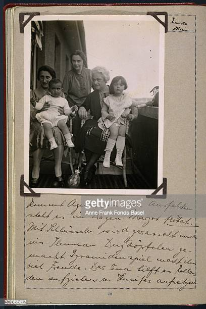 EXCLUSIVE Margot Frank older sister of Anne Frank on her mother Edith Frank's lap Janine Schuster on Lily Kuhn's lap and Helene Schuster taken from...