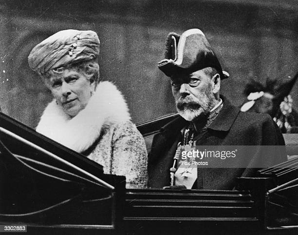 A closeup of King George V and Queen Mary in a carriage on their way to the Knights of St John Ceremony at Westminster Abbey