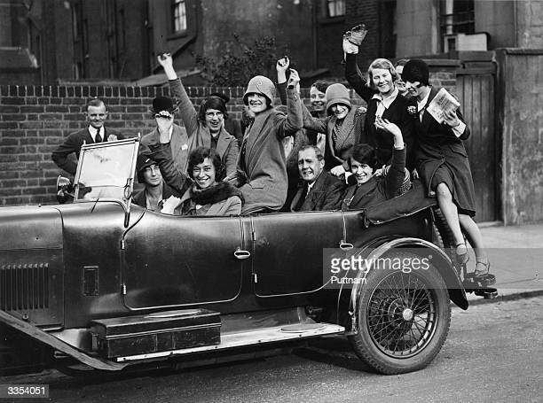 Captain Jan Fraser arriving at a polling station with a carload of flappers, to celebrate a Conservative Party election victory.