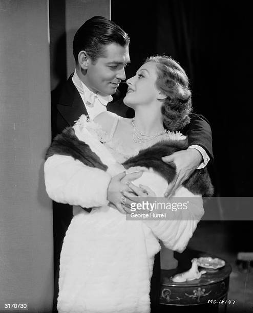 Clark Gable and Joan Crawford in a clinch from the film 'Possessed' directed by Clarence Brown for MGM Costumes by Adrian