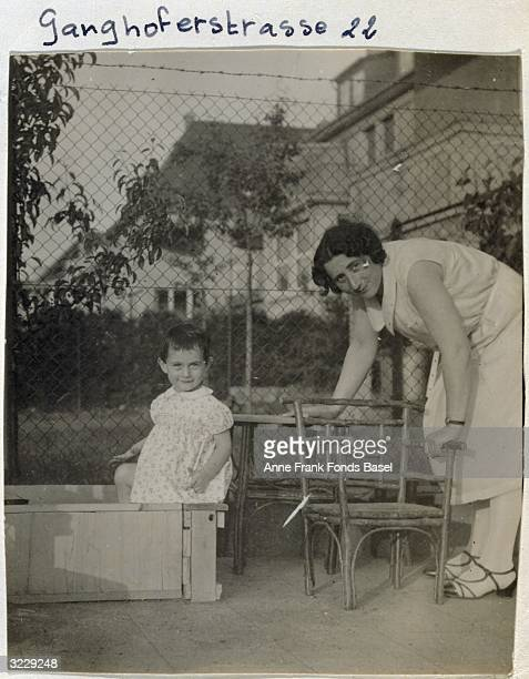 EXCLUSIVE Anne Frank plays in a sandbox while her mother Edith watches over her Frankfurt am Main Germany Taken from Anne's photo album