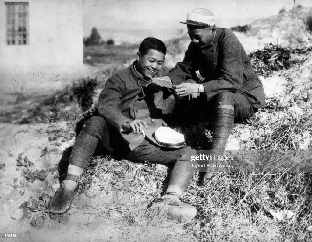 Two Chinese soldiers of the French Foreign Legion peruse a letter from home whilst stationed in Morocco.