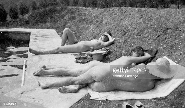 Relaxing around the newly created swimming pool at Ham Spray, home of Frances and Ralph Partridge, are Catherine Carrington, centre and Frances...