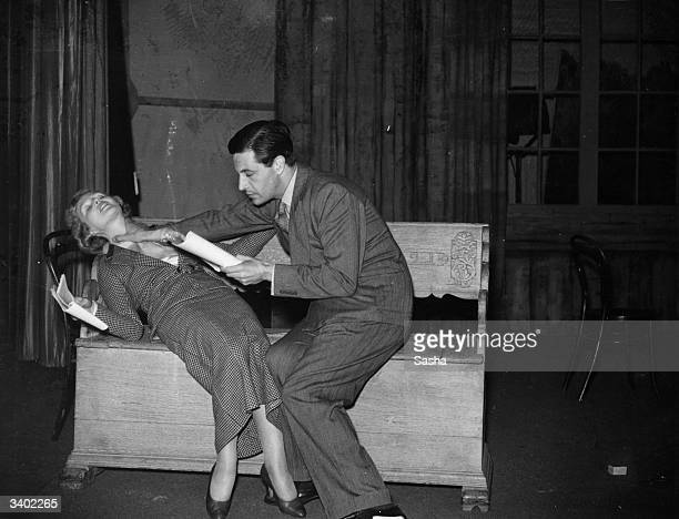 Welsh actor dramatist and composer Ivor Novello rehearses a scene from the play 'Proscenium' with British stage and screen actress Joan Barry at the...