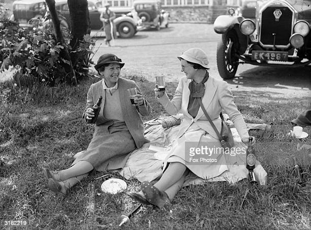 Mrs Munro Smith and Mrs Arthur Morris drinking Pilsner beer at the British Women's Golf Championships at Southport