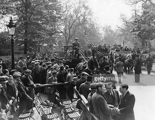 Crowds watching a carthorse parade at Regent's Park London