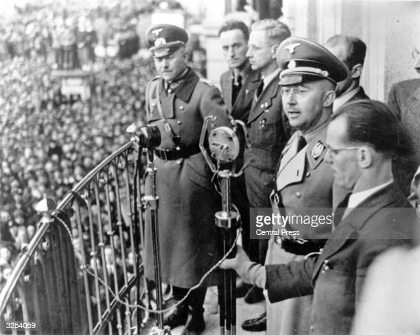 Portrait of Heinrich Himmler , speaking from the town hall in Linz, Austria.