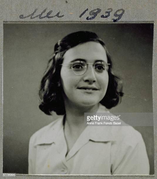 EXCLUSIVE A portrait of Margot Frank the sister of Anne Frank wearing glasses and smiling From Anne Frank's photo album