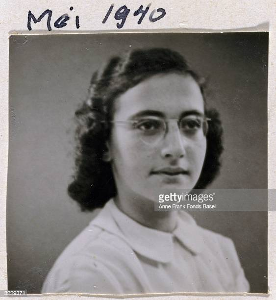 EXCLUSIVE Passport photo of Margot Frank wearing a white blouse and eyeglasses taken from her sister Anne's photo album Amsterdam Holland