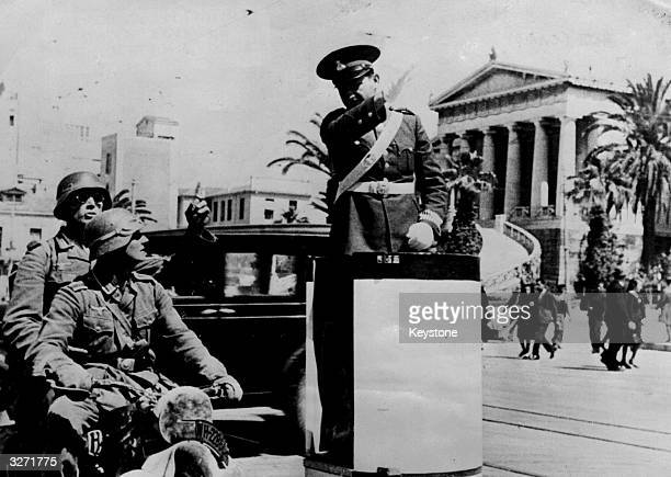 Policeman directs German motorcycle troops in Athens, the capital of conquered Greece.