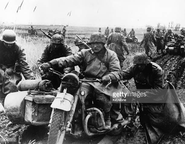 German Army motorcyclists bogged down in mud in Greece.