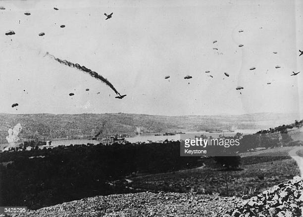German parachutists drop onto Crete during the invasion of Greece.