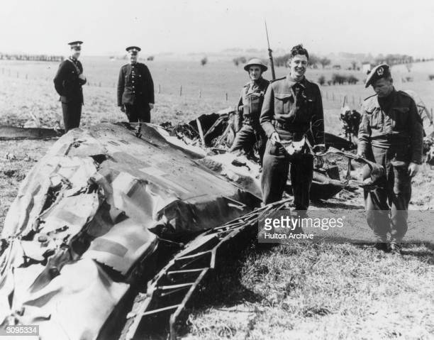 Soldiers and policemen in Eaglesham inspect the wreckage of the Messerschmitt ME110 in which Nazi leader Rudolf Hess made his solo flight to Scotland...
