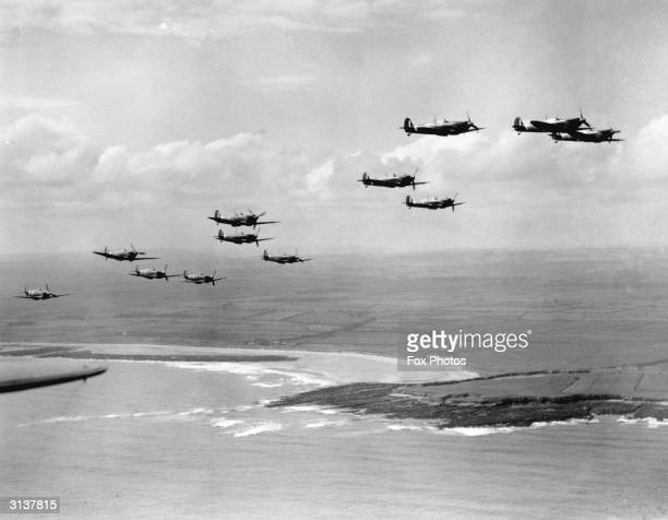 Spitfires on patrol over a coastline during the Battle of Britain