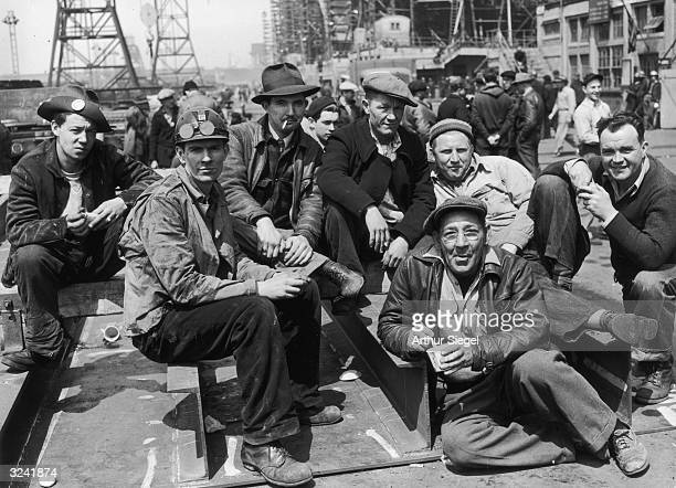 Workers take a break in the Bethlehem-Fairfield shipyards, Baltimore, Maryland, World War II.