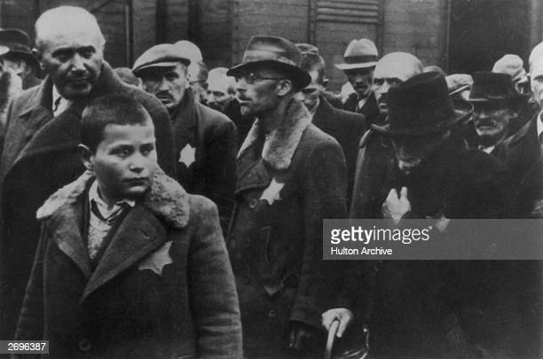 Jewish deportees, with the yellow stars sewn on their coats, arrive at Auschwitz concentration camp.