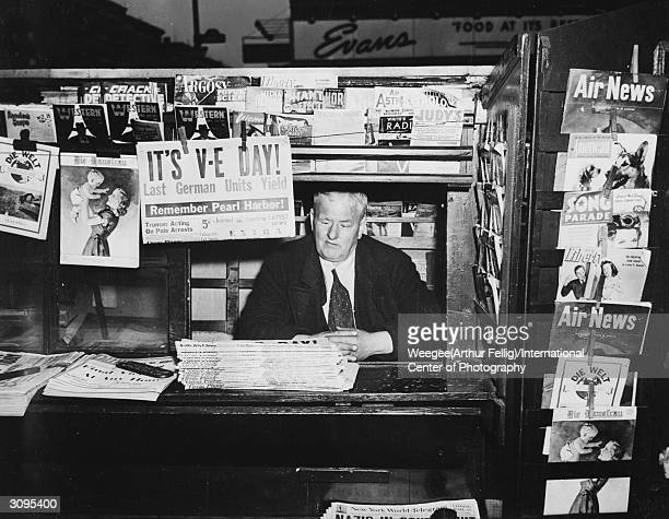 A publication at a newsstand in America announces the surrender of the last German units on VE Day signalling Victory in Europe Photo by...