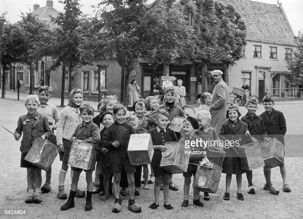 Dutch youngsters who have enjoyed free food supplied by the Allied forces beat empty biscuit tins on full stomachs in Amsterdam.