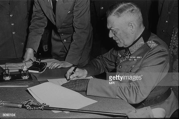 Field Marshal Wilhelm Keitel Hitler's chief military adviser in WW II signing the unconditional surrender to the Allies and Russians in Berlin A...