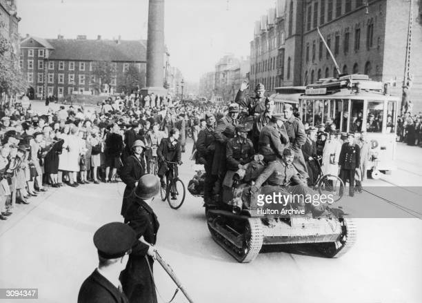 Less than 24 hours after the arrival of British airborne troops the German army of occupation in Denmark was marching back to Germany German troops...