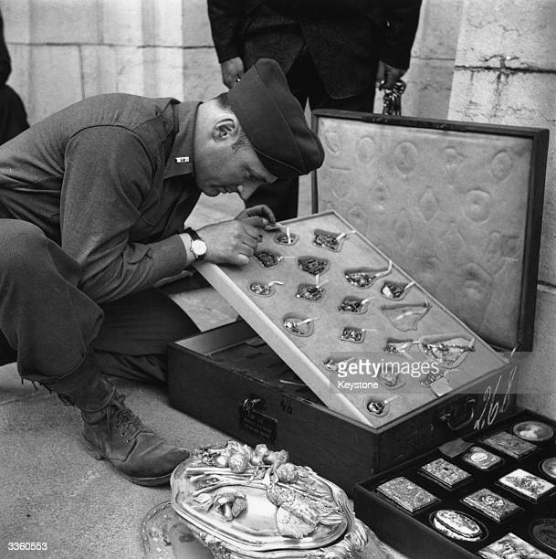 LT James J Walker curator of Fine arts at the Metropolitan Museum in New York examines the Rothschild jewellery collection that was looted by Nazis...