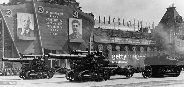 Heavy artillery on parade during a review of the Moscow Garrison troops during the May Day celebrations in Red Square passing posters of Lenin and...