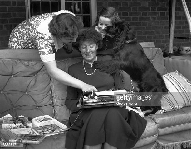 English author and writer of books for children Enid Mary Blyton at her home in Beaconsfield, Buckinghamshire, with her daughters Gillian and Imogen.
