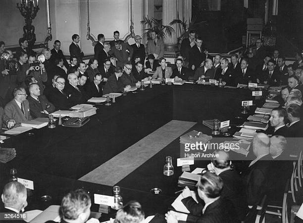A meeting of the foreign ministers of the North Atlantic Treaty Organisation NATO at Lancaster House All are sitting around a large conference table...