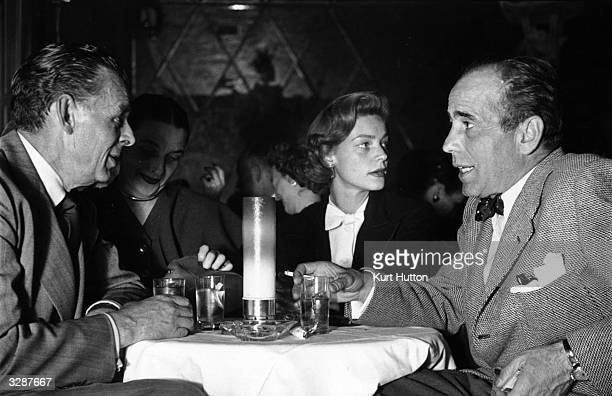 American actor Humphrey Bogart dining out with his fourth wife Lauren Bacall prior to his trip to Europe and Africa to make 'The African Queen'...