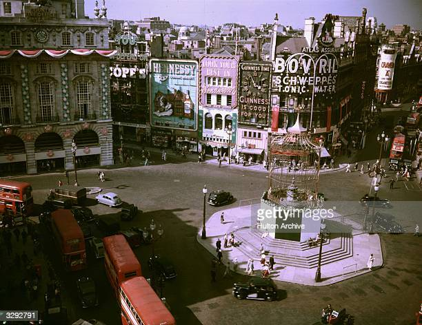 A view of Piccadilly Circus with decorations for the Coronation The statue of Eros is enclosed in a birdcage structure for the celebrations