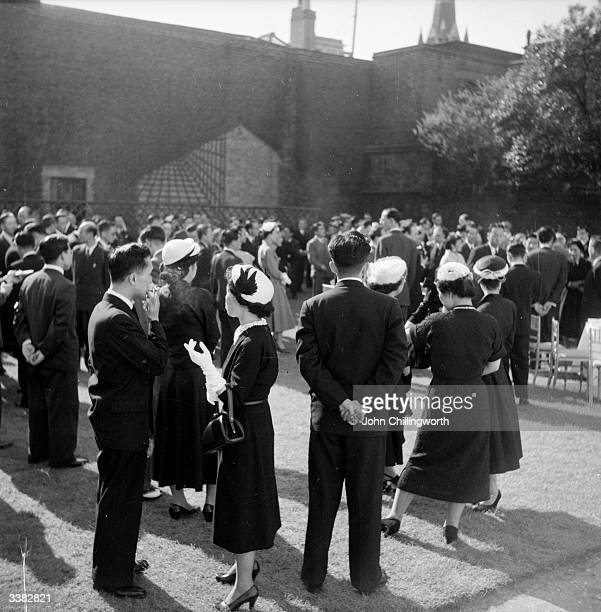 Japanese visitors waiting to catch a glimpse of Prince Akihito in England as a coronation guest of the Queen Original Publication Picture Post 6521...
