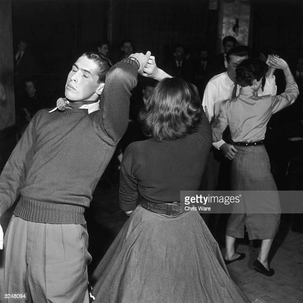 A couple jiving to Humphrey Lyttelton's band at the Jazz Club 100 Oxford Street London