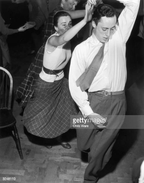 A young couple dancing to Humphrey Lyttelton's band at the Jazz Club 100 Oxford Street London