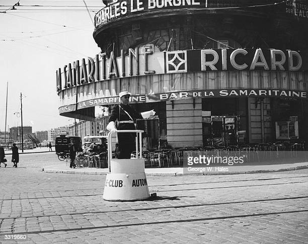 A French policeman on traffic duty in a deserted Quai des Belges Marseille
