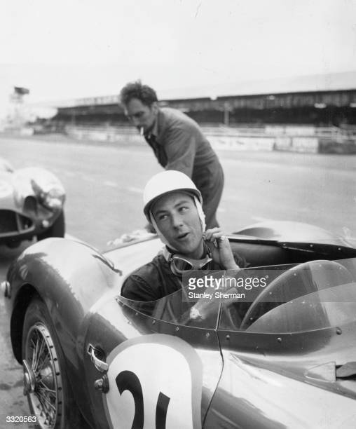 British racing driver Stirling Moss in his Maserati